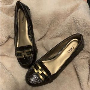 Brown faux leather loafers with gold buckle